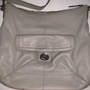 Grey coach purse with pink lining
